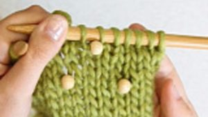 How to knit in multiple beads